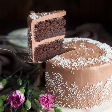 A slice of mini chocolate cake being lifted