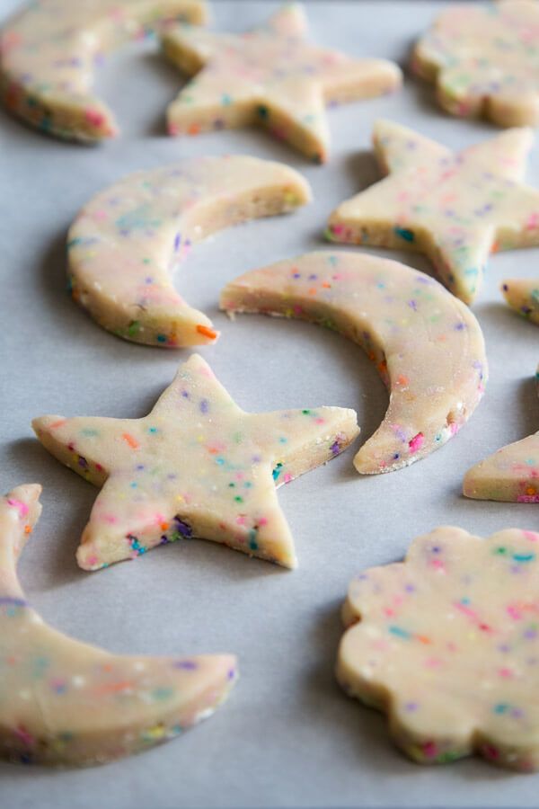 Sprinkle shortbread cookie dough on a baking tray