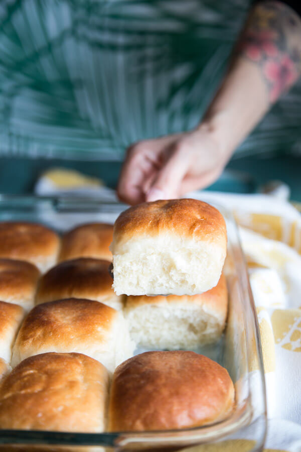 Serving a Samoan coconut bun from the tray