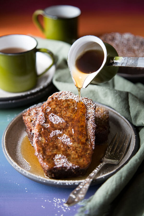 Pouring maple syrup over banana bread french toast