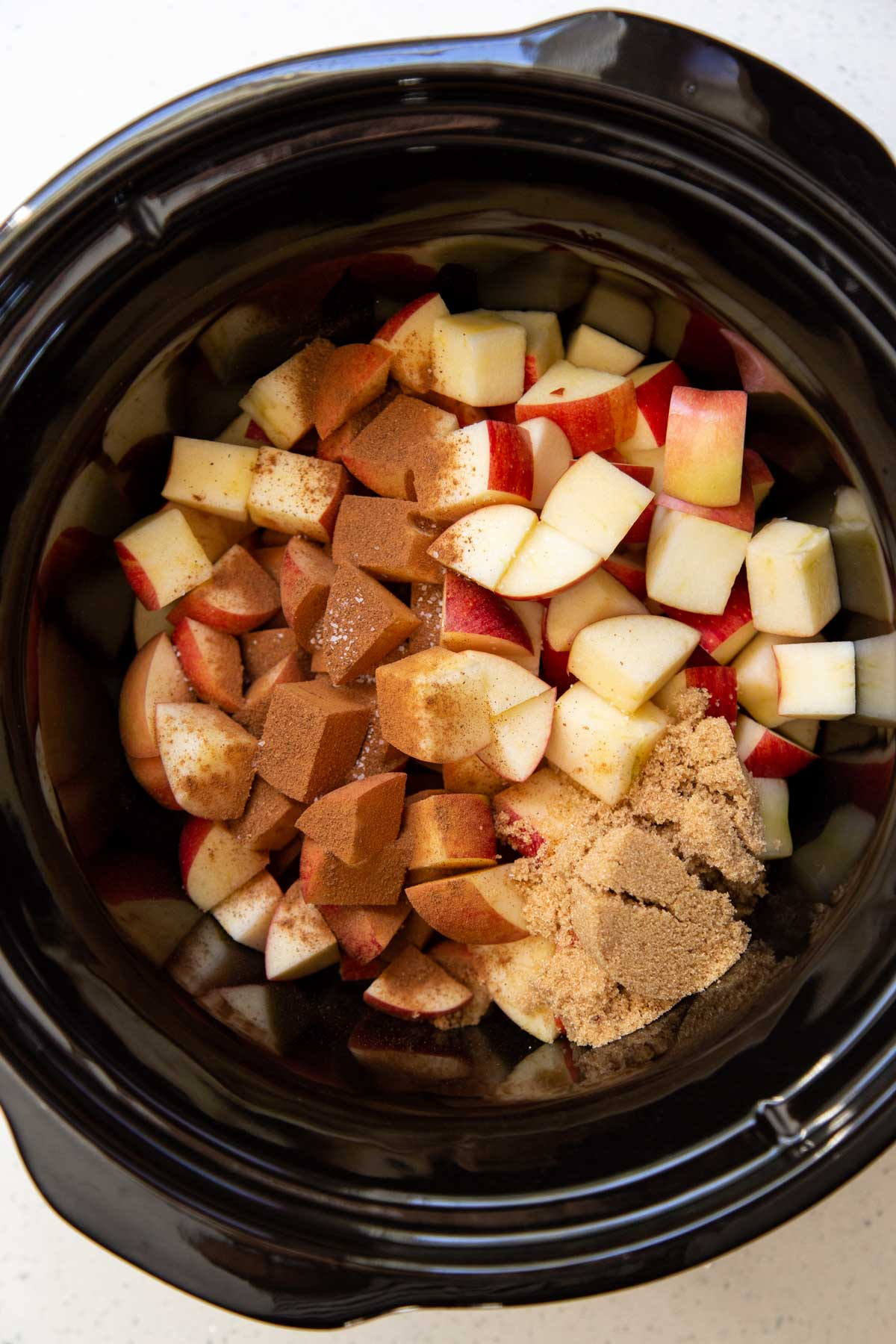 Ingredients for apple butter in a slow cooker
