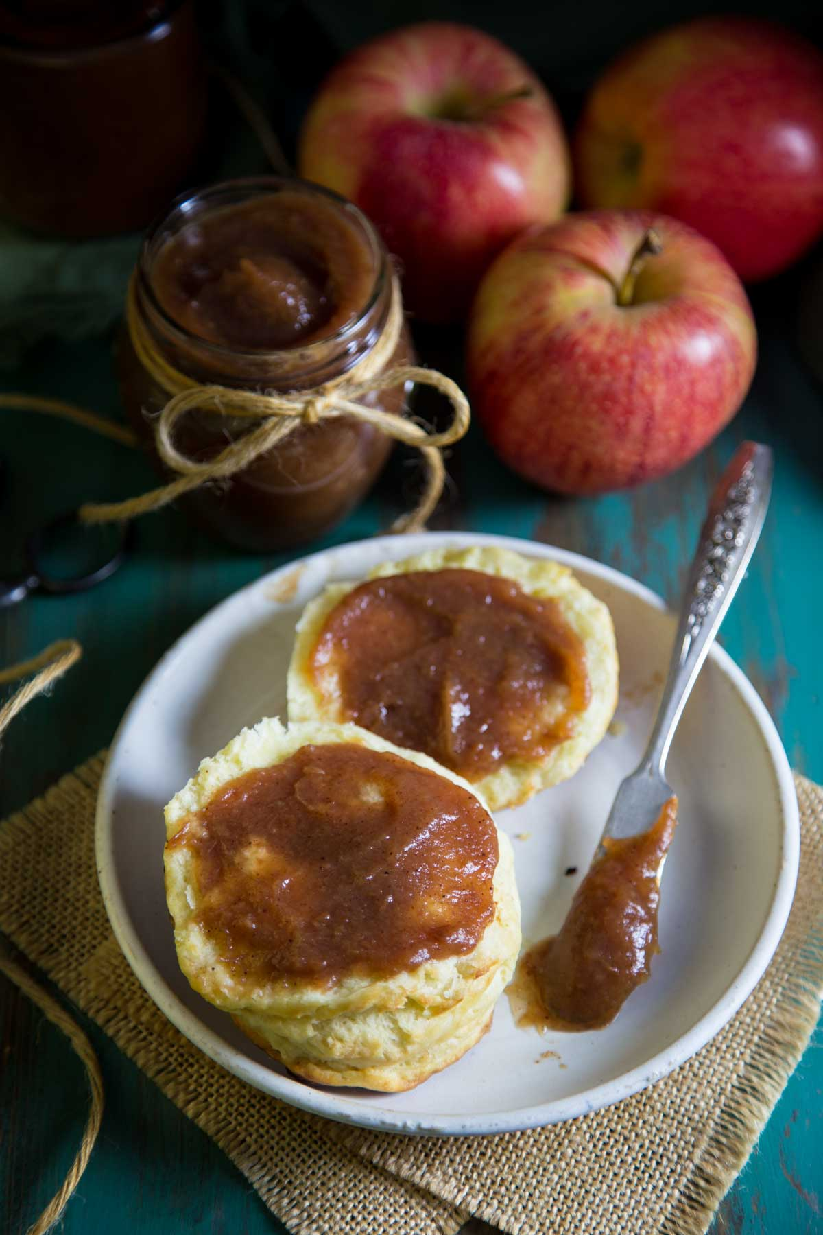 Apple butter spread on a biscuit