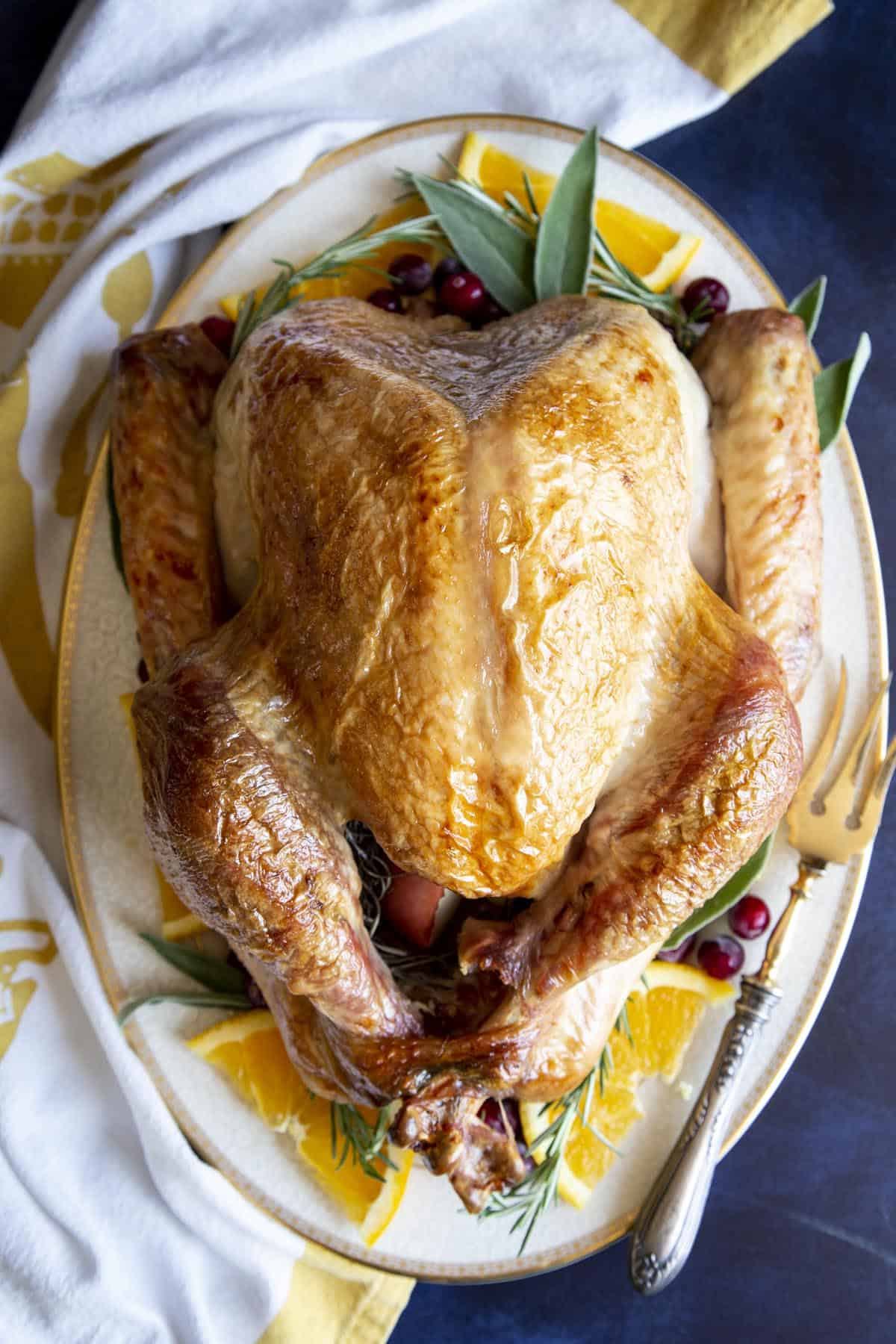 A roast turkey on a serving platter