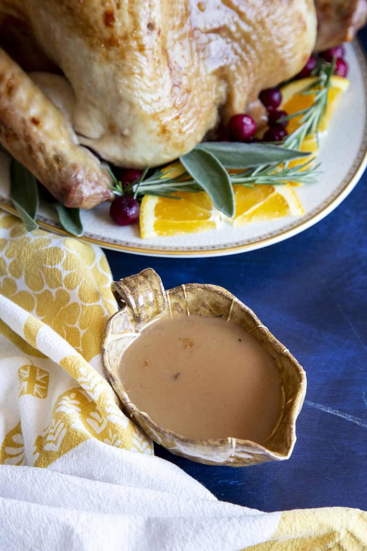 Turkey gravy in a small brown gravy boat