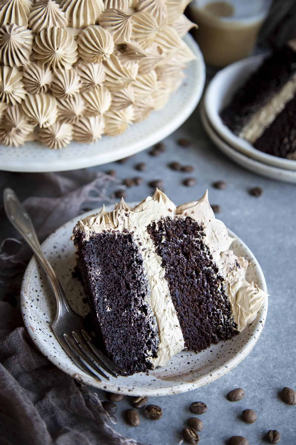 A slice of mocha cake on a plate