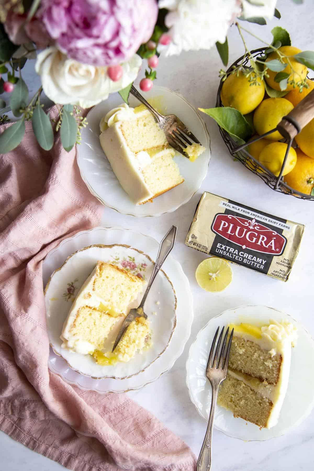 3 slices of lemon cake on plates