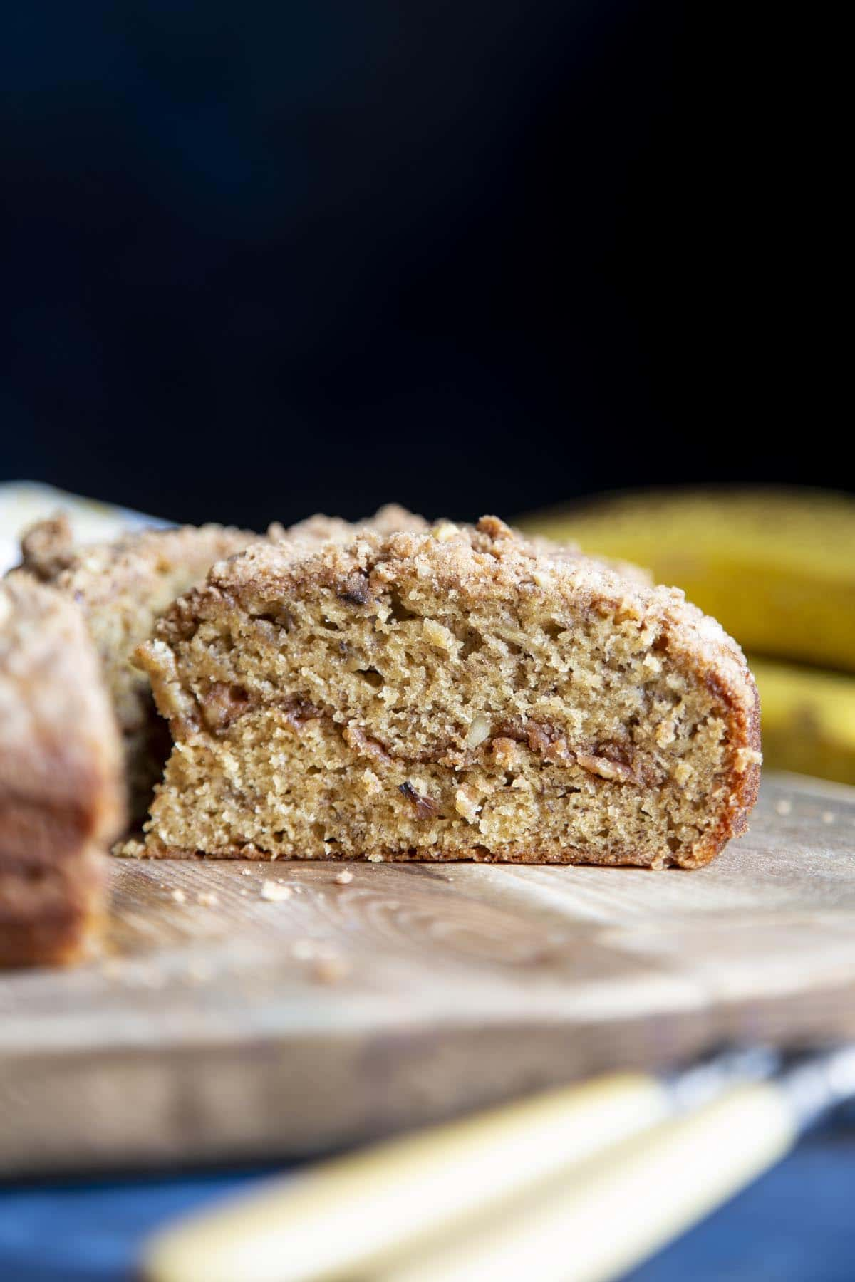 A slice of banana coffee cake with streusel running through the middle.