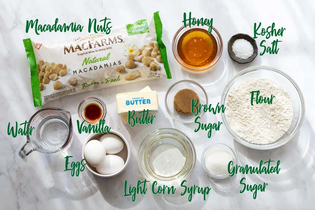 Ingredients for macadamia pie on a marble surface.