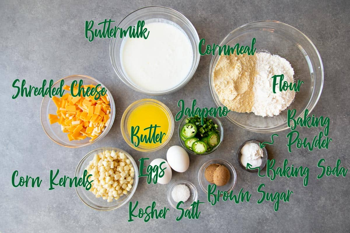 Ingredients for cornbread on a gray surface.