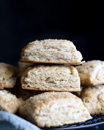A stack of whole wheat biscuits on a wire rack.