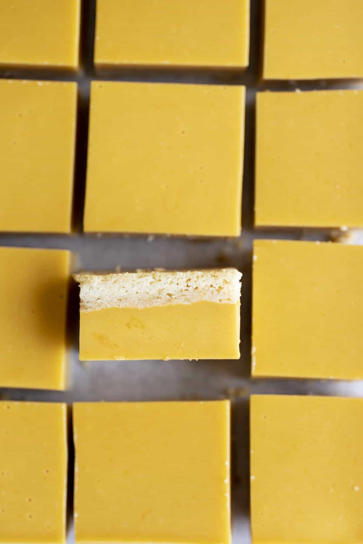 A flat lay photo of mango bars, one bar is standing up on its side.